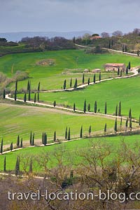 photo of Winding Roads Of The Tuscan Landscape And City Towers
